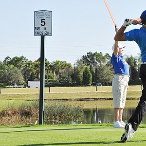 Will Wears hits his tee ball at No. 9 during the first round of the Father/Son Challenge at the Ritz-Carlton Golf Club in Orlando.