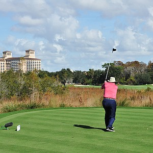Arnold Palmer hits his tee ball at No. 9 during the first round of the Father/Son Challenge at the Ritz-Carlton Golf Club in Orlando.