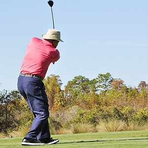 Arnold Palmer hits his tee shot on No. 8 during the first round of the Father/Son Challenge at the Ritz-Carlton Golf Club in Orlando.