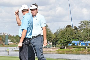 Nick Faldo chats with his son, Matthew, after carding a birdie on No. 18 during the first round of the Father/Son Challenge at the Ritz-Carlton Golf Club in Orlando.