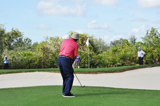 Arnold Palmer hits his third shot on No. 9 during the first round of the Father/Son Challenge at the Ritz-Carlton Golf Club in Orlando.