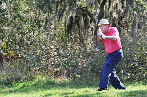 Arnold Palmer hits his second shot on No. 9 during the first round of the Father/Son Challenge at the Ritz-Carlton Golf Club in Orlando.