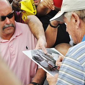 Jack Nicklaus signs autographs after the first round of the Father/Son Challenge at the Ritz-Carlton Golf Club in Orlando.