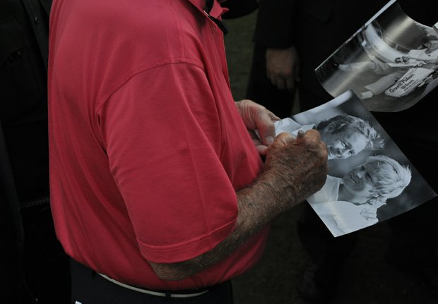 Arnold Palmer signs autographs after the first round of the Father/Son Challenge at the Ritz-Carlton Golf Club in Orlando.