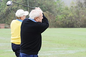 Jack Nicklaus (left) and Arnold Palmer hit balls on the range before the start of the Father/Son Challenge at the Ritz-Carlton Golf Club in Orlando.