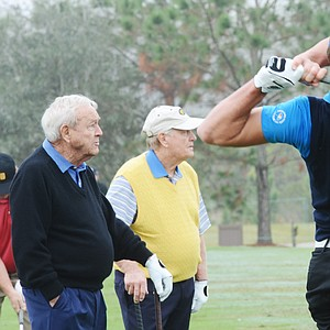 Jack Nicklaus (left) and Arnold Palmer watch Will Wears hit balls on the range before the start of the Father/Son Challenge at the Ritz-Carlton Golf Club in Orlando.