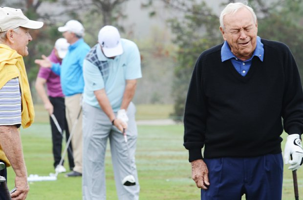 Jack Nicklaus (left) and Arnold Palmer share a laugh on the range before the start of the Father/Son Challenge at the Ritz-Carlton Golf Club in Orlando.