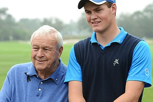 Arnold Palmer (left) and grandson Will Wears pose for a photo before teeing off on No. 1 during the first round of the Father/Son Challenge at the Ritz-Carlton Golf Club in Orlando.