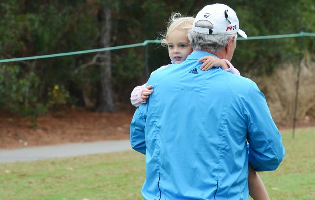 Hale Irwin picks up his granddaughter right after teeing off on No. 1 during the first round of the Father/Son Challenge at the Ritz-Carlton Golf Club in Orlando.
