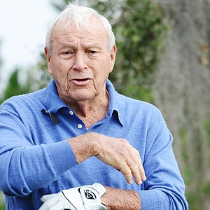 Arnold Palmer waits to tee off on No. 1 during the first round of the Father/Son Challenge at the Ritz-Carlton Golf Club in Orlando.