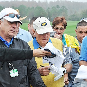 Jack Nicklaus signs autographs before heading to No. 1 during the first round of the Father/Son Challenge at the Ritz-Carlton Golf Club in Orlando.