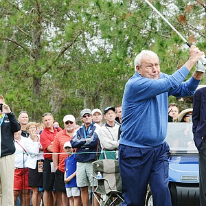 Arnold Palmer hits his first tee shot of the day on No. 1 during the first round of the Father/Son Challenge at the Ritz-Carlton Golf Club in Orlando.