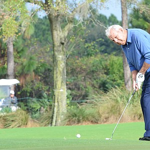 Arnold Palmer hits his birdie putt at the 2nd hole during the first round of the Father/Son Challenge at the Ritz-Carlton Golf Club in Orlando.