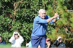 Arnold Palmer hits his tee ball at the par-3 4th hole during the first round of the Father/Son Challenge at the Ritz-Carlton Golf Club in Orlando.