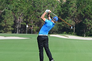Will Weams hits his second shot into the par-5 5th hole during the first round of the Father/Son Challenge at the Ritz-Carlton Golf Club in Orlando.