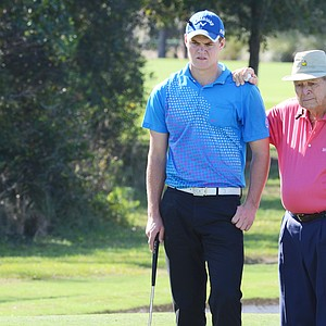 Will Wears and grandfather Arnold Palmer wait for their second putt on the 7th green during the first round of the Father/Son Challenge at the Ritz-Carlton Golf Club in Orlando.