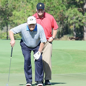 Gary Nicklaus (right) lines up a putt with his dad, Jack, during the first round of the Father/Son Challenge at the Ritz-Carlton Golf Club in Orlando.