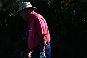 Arnold Palmer reacts to a missed putt on the 7th green during the first round of the Father/Son Challenge at the Ritz-Carlton Golf Club in Orlando.