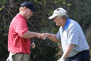 Gary Nicklaus, left, gets a fist bump from dad, Jack, after making birdie at the 9th hole during the first round of the Father/Son Challenge at the Ritz-Carlton Golf Club in Orlando.