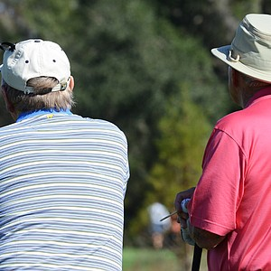 Arnold Palmer (right) and Jack Nicklaus watch Palmer's grandson, Will Wears, hit his tee shot on the 9th hole during the first round of the Father/Son Challenge at the Ritz-Carlton Golf Club in Orlando.