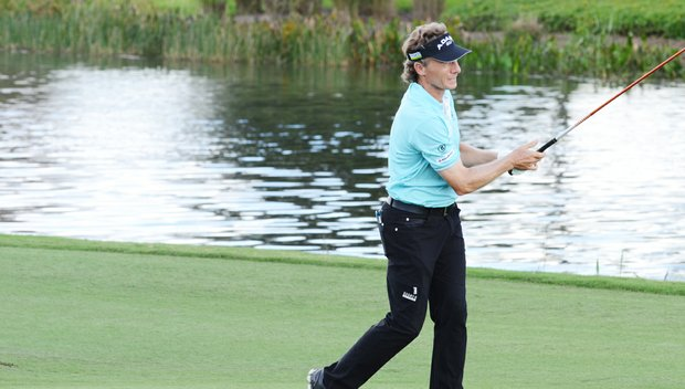 Bernhard Langer hits from the middle of the 18th fairway during the first round of the Father/Son Challenge at the Ritz-Carlton Golf Club in Orlando.