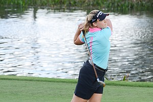 Christina Langer hits from the middle of the 18th fairway during the first round of the Father/Son Challenge at the Ritz-Carlton Golf Club in Orlando.