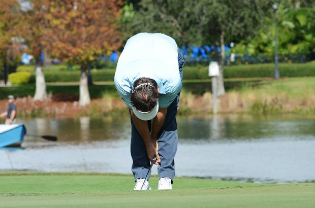 Nick Faldo reacts to missing an eagle putt on the 18th green during the first round of the Father/Son Challenge at the Ritz-Carlton Golf Club in Orlando.