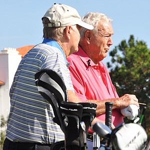 Jack Nicklaus and Arnold Palmer chat at the back of the 5th tee box during the first round of the Father/Son Challenge at the Ritz-Carlton Golf Club in Orlando.