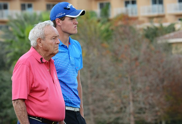 Arnold Palmer (left) stands with his grandson, Will Wears, on the front of the 18th green during the first round of the Father/Son Challenge at the Ritz-Carlton Golf Club in Orlando.