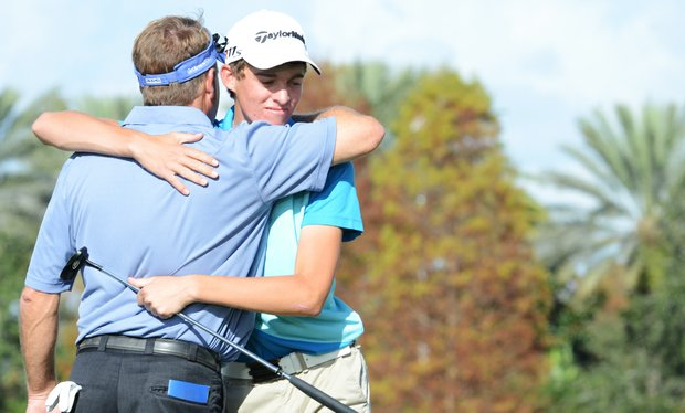 Taylor Funk (right) hugs his father, Fred Funk, on the 18th green during the Father/Son Challenge at the Ritz-Carlton Golf Club in Orlando.