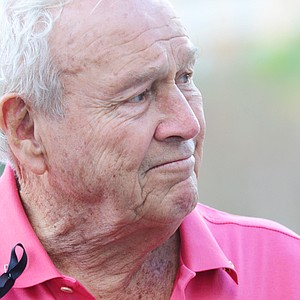 Arnold Palmer off the back of the 18th green at the Father/Son Challenge at the Ritz-Carlton Golf Club in Orlando.