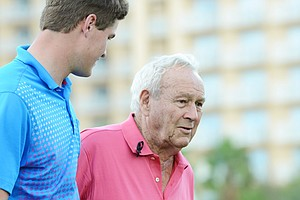Arnold Palmer (right) with grandson Will Wears off the back of the 18th green at the Father/Son Challenge at the Ritz-Carlton Golf Club in Orlando.