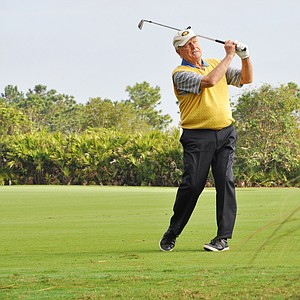 Jack Nicklaus hits his second shot at No. 3 during the first round of the Father/Son Challenge at the Ritz-Carlton Golf Club in Orlando.