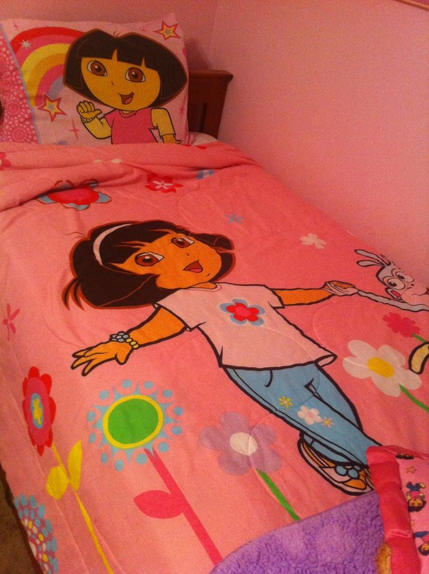 The Dora the Explorer bed spread in the rental house.