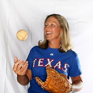 Angela Stanford shows off her love of Texas Rangers.