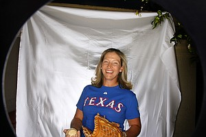 Angela Stanford shows off her love of the Texas Rangers during a shoot at the Kraft Nabisco in Palm Springs, Calif.