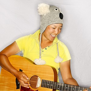 Tiffany Joh with her hats and guitar photographed during the Founder's Cup in Phoenix, Arizona.