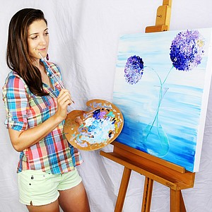 Sandra Gal with one of her other passions, painting.