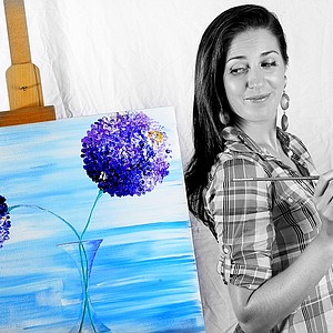 Sandra Gal with her latest hobby of painting.