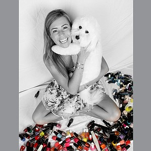 Paula Creamer and her dog Studley. Studley is Paula's off course hobby. Like a couple of best friends, Studley is Paula's constant companion.