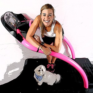Paula Creamer and Studley in her home gym in Orlando, Fla. Studley hangs with Paula everywhere.