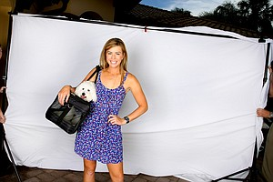 Paula Creamer and Studley showing off Studley's travel gear.
