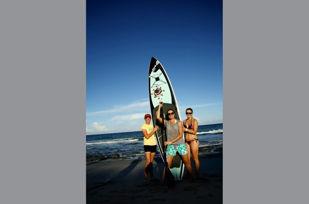 Stacy Lewis paddle boards in her off time as one of her hobbies. Here she and friends Alison Walshe, center, and Cindy LaCrosse, right, pose on the beaches in Jupiter.