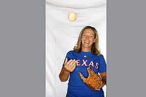 Angela Stanford shows off her love of baseball and the Texas Rangers since she was a child.