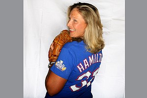Angela Stanford peeks around from her Josh Hamilton T-shirt. Hamilton was part of the Texas Rangers but is now with the Los Angeles Angels.