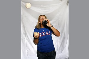 Angela Stanford shows off her juggling skills of two of her favorites baseball and Dr. Pepper.