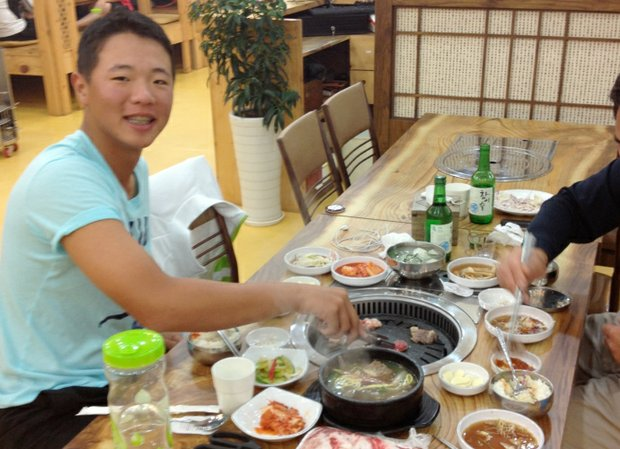 Andy Zhang taking in the Korean cuisine, which he says might pack on a few pounds if you aren't careful.