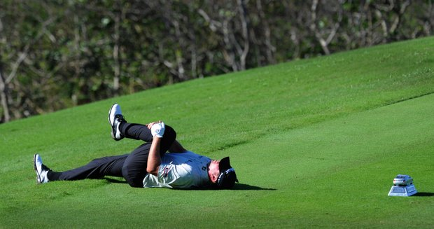 Steve Stricker stretches out his back on the 18th tee box during the second round of the Hyundai Tournament of Champions at Plantation Course.