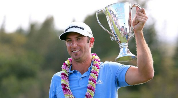 Dustin Johnson celebrates with the Hyundai Tournament of Champions Cup following the final round.