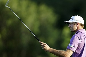 Dustin Johnson acknowledges the crowd after making an eagle on the 18th hole during the second round at the Hyundai Tournament of Champions.